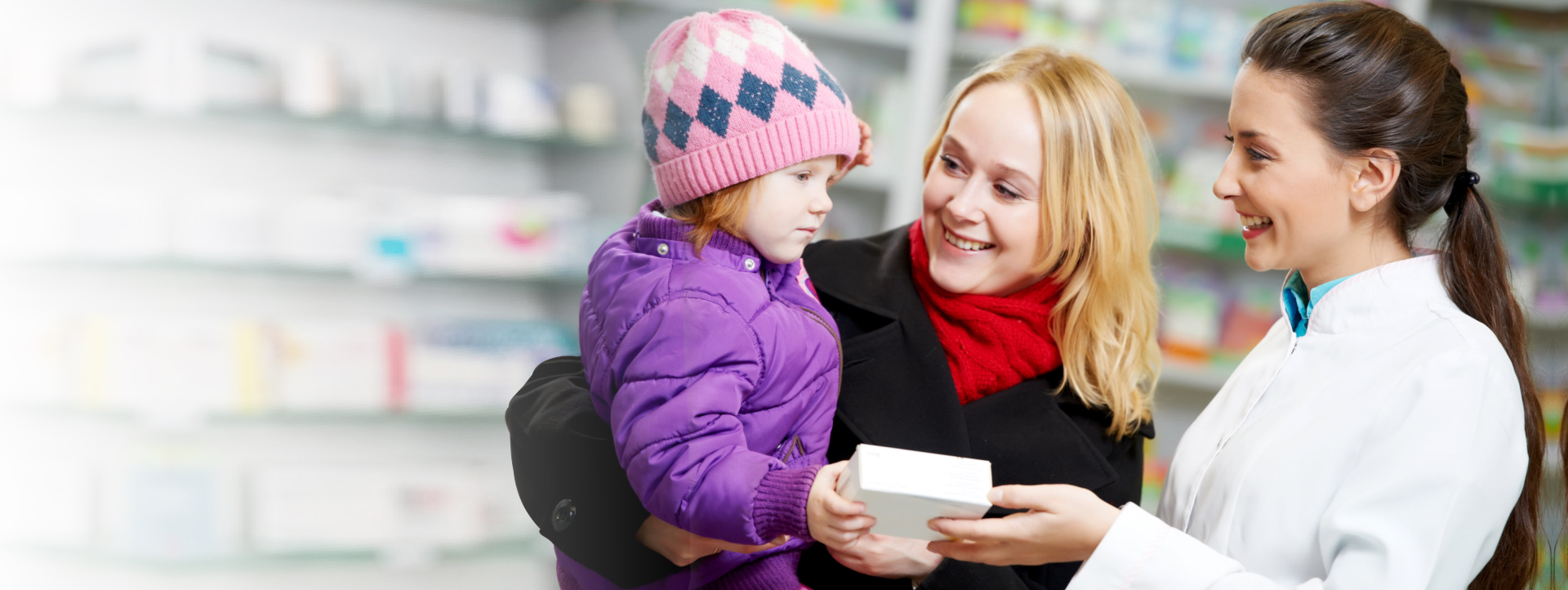 pharmacist discussing medicine to mother with child